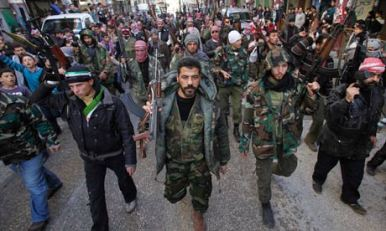 Syrian rebels march during a demonstration in Idlib